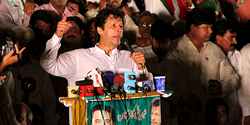 KHAN PUSHES FOR PM'S RESIGNATION