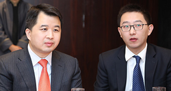 Xia Zhu (l), senior marketing manager from AsiaPay, with Xudong Zeng, manager for sustainability and community engagement at Standard Chartered Bank