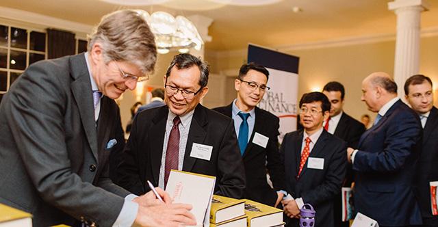 Executives from Bank Mandiri, Vietin Bank, NBK and Ardshinbank lining up for David Lough's book on Churchill's finances