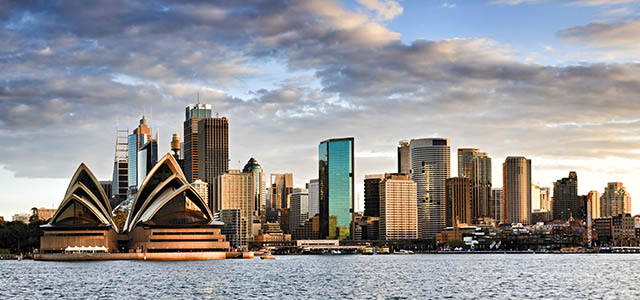 Which city was created to settle a dispute between Melbourne and Sydney?